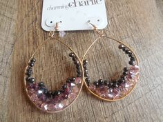 """This gorgeous pair of hoop earrings from Charlie Charlie is quite charming indeed. Earring Details: Length: 3"""" Color: Gold tone Type: Fishhook Condition: Brand New!"""