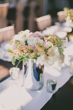 centerpiece in silver vase, photo by Dave Richards http://ruffledblog.com/west-hills-california-wedding #flowers #centerpieces #weddingideas