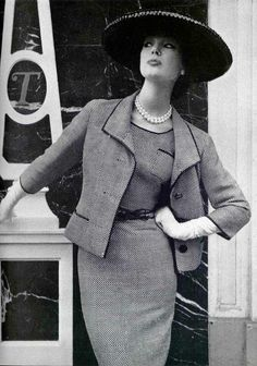 Ivy Nicholson in black and white rayon dress belted with matching 3-button jacket by Jean Patou, photo by Silverstein at Vogue Studio, Paris, 1957