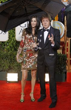 Paul looking quite dapper and his chic wife Nancy. The perfect couple!