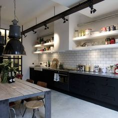 Kitchen Design Inspiration Industrial chic kitchen with black cabinets and white shelves with large vintage industrial lights, white subway tiles Industrial Chic Kitchen, Loft Industrial, Loft Kitchen, Shabby Chic Kitchen, Industrial Interiors, New Kitchen, Kitchen Interior, Kitchen Ideas, Industrial Design