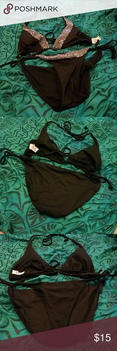 Black Bikini with Iridescent Sequins by Old Navy! NWOT. Black triangle bikini top embellished with sequins, ties in back and around neck, lined and has light padding which is removable. Bottoms have a line of matching sequins along the front waist and are lined in black. Gorgeous and eye-catching suit! Please note the last picture--it shows a spot on the left bra triangle that is missing a single sequin. It is not noticeable from afar but is a flaw that I wanted to point out. Priced…