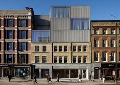 Duggan Morris contrasts mesh with brickwork at Shoreditch office block