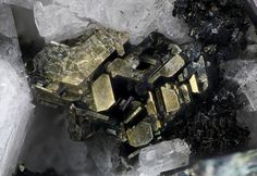 Annite, KFe2+3(AlSi3O10)(OH)2, Água de Pau Volcano, Água de Pau Massif, San Miguel Island, Azores District, Portugal. Fov 2.17 mm. Group of gray hexagonal crystals of annite. Copyright: © L.C. 2016
