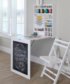 This clever table folds up into a chalkboard on the wall and opens to reveal a storage cabinet and workspace, great for any small room. Laundry Folding Tables, Folding Walls, Fold Away Desk, Fold Down Table, Dorm Storage, Storage Ideas, Storage Spaces, Storage Solutions, Craft Rooms