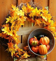Autumn Wreath .... colorful leaves on a grapevine wreath ... small buckt with mini-pumpkins ... sweet!
