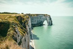 Etretat, Normandy, France / Amazing cliff rock view with blue turquoise transparent ocean water. Greenery nature and famous north french landscape. Shop this poster, art print or frame for your wall in your home decoration by Best Places To Travel, Places To Go, Etretat France, Argentina South America, Desert Location, Cheap International Flights, Port Of Spain, Station Balnéaire, Flight And Hotel