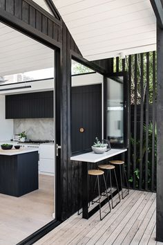 The distinct roofline of Pleated House not only pays homage to midcentury architecture, but also makes room for clerestory windows that flood the interiors with light. Black Cladding, Timber Cladding, External Cladding, Architecture Design, Australian Architecture, Indoor Outdoor Kitchen, Outdoor Living, Outdoor Kitchens, Outdoor Rooms
