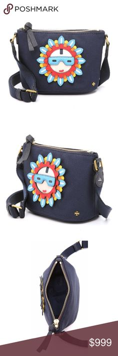 """NWT Tory Burch Flower Child Appliqué Bag A spunky look with a boho-chic vibe, this nylon canvas mini-bag features a fun flower-child applique in vibrant textured leather. A wide adjustable strap trimmed with antiqued hardware adds to the casual look of this laid-back crossbody. The zipper top opens to a roomy interior with card slots so that you can leave your wallet behind. Nylon with leather appliques. Measures: 6.5"""" L x 4.5"""" H x 3.25"""" D, 13"""" adjustable shoulder strap drop, 3 interior card…"""