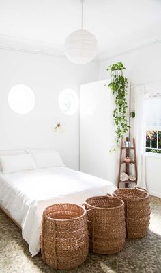 Add organization and character to your sleek white room with a few woven baskets