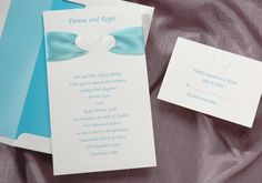 Wedding Invitations by Splash Designz  Tropical satin ribbon is included with this invitation. Your names appear above the embossed hearts that are laced with the ribbon.