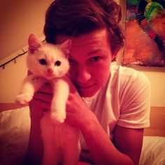 Tom Holland .> He has a cat? Another reason to love him :P