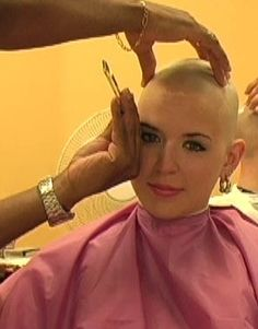 LOVE IT, in a barbers chair, her head being shaved smoothed and enjoying it.