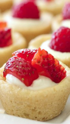 Mini Berry Tarts _ Sugar cookie tarts filled with sweetened cream cheese & topped with berries. This recipe has a major shortcut, & I am not ashamed… it's refrigerated cookie dough!