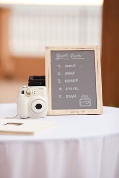 Instead of the same old guest sign-in book, we set up a Polaroid photo book for guests to sign fun photos of themselves throughout the night. Man, are those pics fun to look at even now! Cute chalkboard sign was made by my sis...