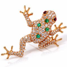 This fabulous Oscar Heymen frog pin is crafted in solid 18K yellow gold. This Oscar Heyman frog pin is covered by some 172 round cut diamonds approx. 6.15 ct, E-F color, VVS clarity, pave set, and 4 genuine cabochon cut genuine Colombian emeralds approx. 0.70ct, pave set. Two eyes bezel set with two cabochon genuine Rubies approx: 0.42ct and is detailed throughout this gorgeous masterpiece. This Brooch pin is signed and numbered. This Oscar Heyman pin is in like NEW condition. it is ...