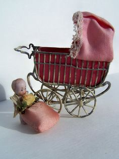 Vintage Toy, Antique German Schweitzer Doll House Miniature Baby Carriage  1900s with Original Bisque Baby. $99.95, via Etsy.