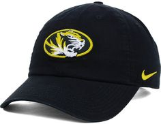 Represent the your favorite college team with this Nike NCAA Dri-FIT Tailback cap that features the Missouri Tigers logo at the front and an adjustable buckle for a perfect fit. Low crown Structured fit Normal bill Raised embroidery team wordmark at front Embroidered Nike swoosh logo at left side Six panels with six eyelets Dri-FIT technology Adjustable slide closure Officially licensed Cotton Spot clean