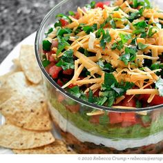 My dip has a little more pizazz than the usually suspected 7-layers out there, and it's vegan! By replacing the cheese with savory olives and scallions and swapping sour cream for smooth and tangy hummus, this recipe sings with flavor and saves the animals...