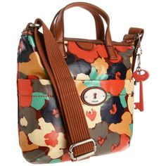 Fossil Crossbody bag. I got this awhile ago on sale, so there's a slim chance to find it now. However, the material is very durable and long lasting, and many fossil purses are made with the same material. When I wear it cross-body it does wrinkle a bit, but that's to be expected.