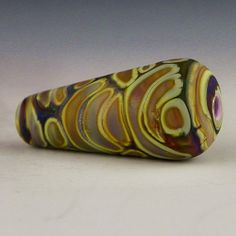 an etched cone focal in earthy colors done in by PolychromeBeads, $13.00