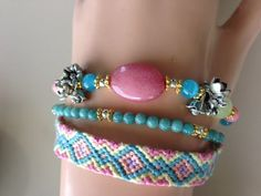 Pastel friendship bracelet bouquets of Tibetan by MAGICALUNIVERSE, $30.00 There is a cute rhinestone addition that goes with this.