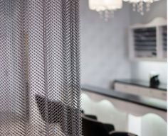 Cascade Coil architectural drapery on display at Studio So Lara in Kichener, Ontario, Canada. Sliding Wall, Material Board, Student Living, Window Dressings, Metal Mesh, Window Curtains, Pattern Wallpaper, Drapery, Interior Architecture