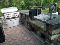 The grill to complete your outdoor kitchen.  A parrilla grilling insert for wood or charcoal.