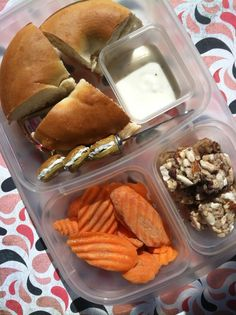 """Bagel with strawberry Laughing Cow cream cheese, carrot chips and ranch, and blueberry almond bites from my Naturebox."""