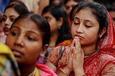 Deep in Devotion - woman praying in Park Circus, Kolkata, India. Photo by Samir D.
