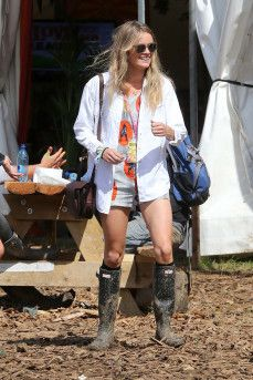 On Day two Cresida wore a printed playsuit with a white denim jacket and (you guessed it) Hunters.