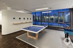 MTV Networks Headquarters in Berlin by Dan Pearlman; I like the floating shelf below the little screens...cool ping pong table too...idea for large open space? Co. break area??
