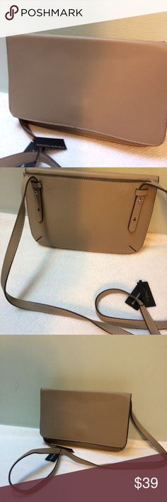 NWT Banana Republic Leather Crossbody Handbag Banana Republic Italian Leather Convertible  Crossbody/clutch Mushroom  Luxe Italian leather elevates this convertible  crossbody.  PRODUCT DETAILS Magnetic closure External slot pocket. Adjustable, removable shoulder strap.  SIZING Height 6.3 in. (16cm) Width 9.5 in. (24cm) Depth 0.75 in. (2cm) Shoulder strap length (max) 46 in. (116.8cm)  FABRIC & CARE Imported. 100% leather. Banana Republic Bags Crossbody Bags
