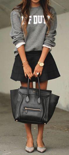 black celine bag with mini skirt + sweatshirt