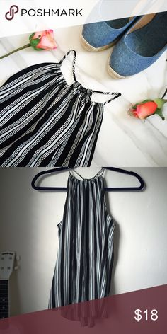 Striped Halter Tank Top I cut the tags but I'm pretty sure this is from Banana Republic. I like to wear it with a denim skirt and sandals because it's pretty long on me. Would be ideal for a S or tall XS. Make an offer, 15% off bundles! Banana Republic Tops Blouses