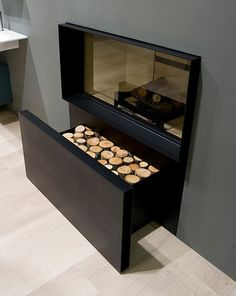 Firewood drawer under fireplace - a minimalist's dream!