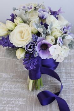 Such a lovely mix for a Spring bouquet, purple and lilac anemones with cream roses and blue hyacinths.