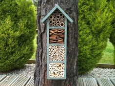 Look at this great house for Mason or Leafcutter bees (which are non-aggressive and good for pollinating gardens). Classy and fun -- from etsy.com. From MOTHER EARTH NEWS magazine.