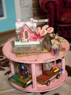 The Junk Gypsies sisters created a kids' mobile craft station using an old wooden spool. They attached wooden dowels to separate the stations and screwed on jar lids underneath the top surface to hold crafting tools.