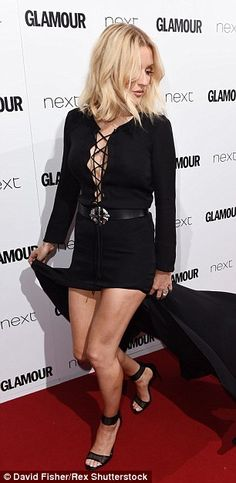Laced up: Ellie Goulding chose an unusual number for the big London night out, with her bl...