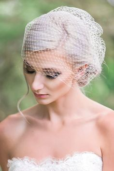 White Lace Wedding Dress With Bun Hairstyle