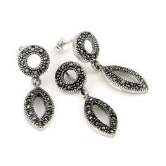 Round And Marquise Marcasite Set Shop4Silver. $36.30. Approximate pendant Width: 10 MM (0.39 INCHES). Approximate pendant Length: 30 MM (1.17 INCHES). Save 59%! Silver Rounds, Marcasite, Types Of Metal, Free Gifts, Jewelry Sets, Crochet Earrings, Pouch, Beaded Bracelets, Sterling Silver