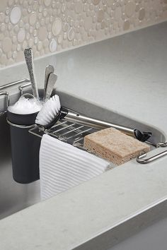 The Container Store is a haven for storage solutions to make the most of any small space, nook, or cranny. This chrome-plated steel sink caddy means a no-rust, easy storage for utensils, sponges and more. #affiliate
