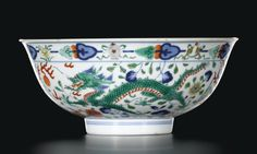 A WUCAI 'DRAGON AND PHOENIX' BOWL. SEAL MARK AND PERIOD OF JIAQING Diam 15 cm