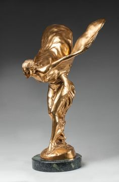 Spirit of Ecstasy (or Flying Lady), emblem of Rolls-Royce. Charles Robinson Sykes (1875-1950) | gilded bronze, green marble base