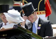 All smiles: Prince Harry beams as he doffs his hat to the Queen as he is driven down the racecourse alongside Her Majesty, Prince Andrew and the Duke of Edinburgh