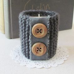 Knit Candle Holder- handmade with linen trim and wooden buttons. $10.00, via Etsy.