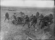 MINISTRY INFORMATION FIRST WORLD WAR OFFICIAL COLLECTION (Q 2035)   Battle of the Scarpe. Men of the Royal Horse Artillery hauling a captured German field gun into position for use against the enemy; Arras-Cambrai Road, April 1917