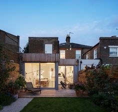 Highlever House by Haptic Architects is a complete refurbishment and extension of a Victorian semi-detached house in West London. The project has two parts, an extension to the existing house and a garden studio facing it.