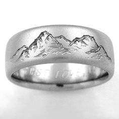 Unique Titanium ring with carved mountain range on approximately of the ring a handcrafted titanium ring by Exotica Jewelry